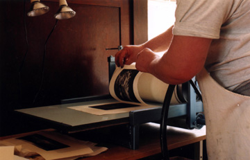 image of David Ladmore revealing a  finished print