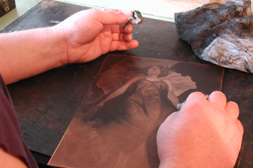 image of David Ladmore inking a mezzotint plate